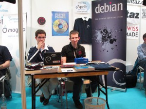 The Debian Booth (Tanguy on the left, Raphaël on the right)